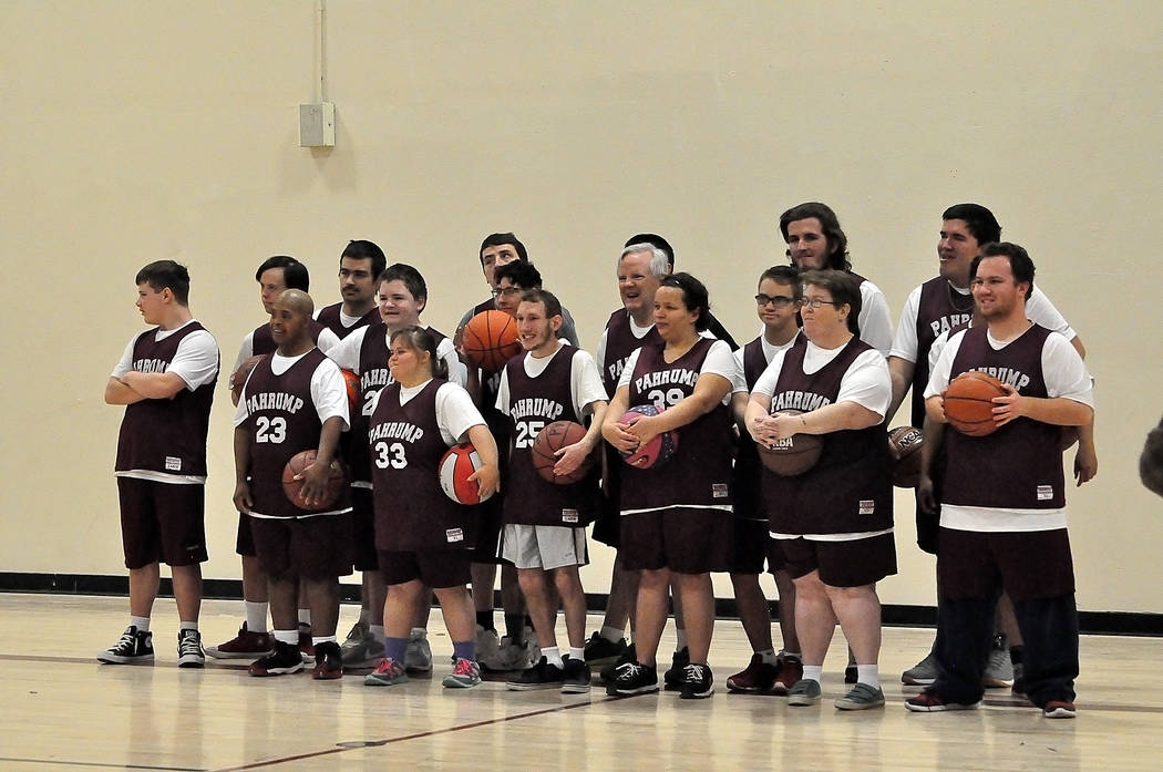Horace Langford Jr./Pahrump Valley Times Pahrump Special Olympics basketball players pose for a group photo at their last practice before the Southern Nevada regional tournament this weekend in La ...