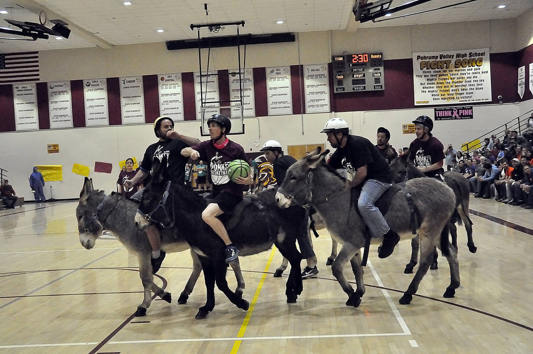 Horace Langford Jr./Pahrump Valley Times  A fast break is never really a fast break in donkey basketball, but the March 2 event raised $3,000 for Rosemary Clarke Middle School and Pahrump Valley H ...