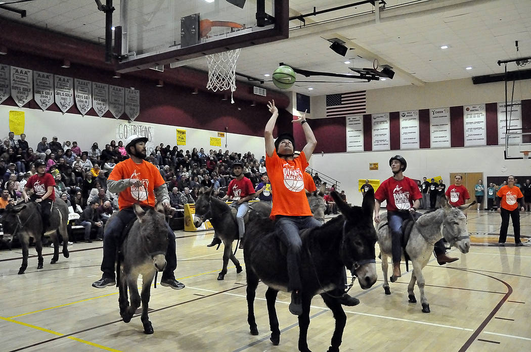 Horace Langford Jr./Pahrump Valley Times  Donkeys don't always help humans play defense, as this two-on-none situation shows during the March 2 donkey basketball game sponsored by Rosemary Clark ...