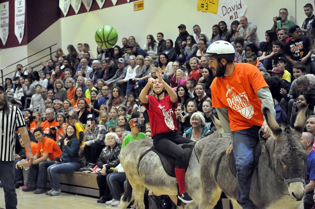 Horace Langford Jr./Pahrump Valley Times  Sometimes an outside shot is the only shot a donkey will allow a player to have, as players for eight teams learned March 2 during the annual donkey baske ...