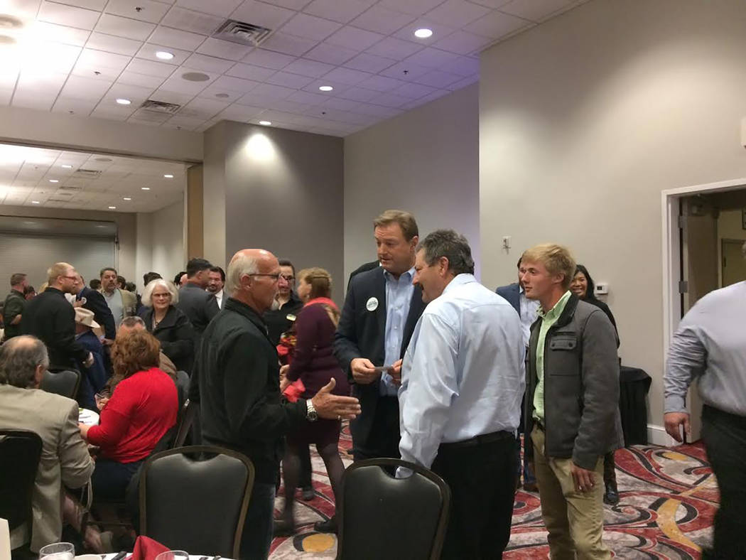 Robin Hebrock/Pahrump Valley Times U.S. Senator Dean Heller spent much of the Lincoln Dinner conversing with attendees. He is pictured speaking with Ski Censke, a professional auctioneer who offer ...
