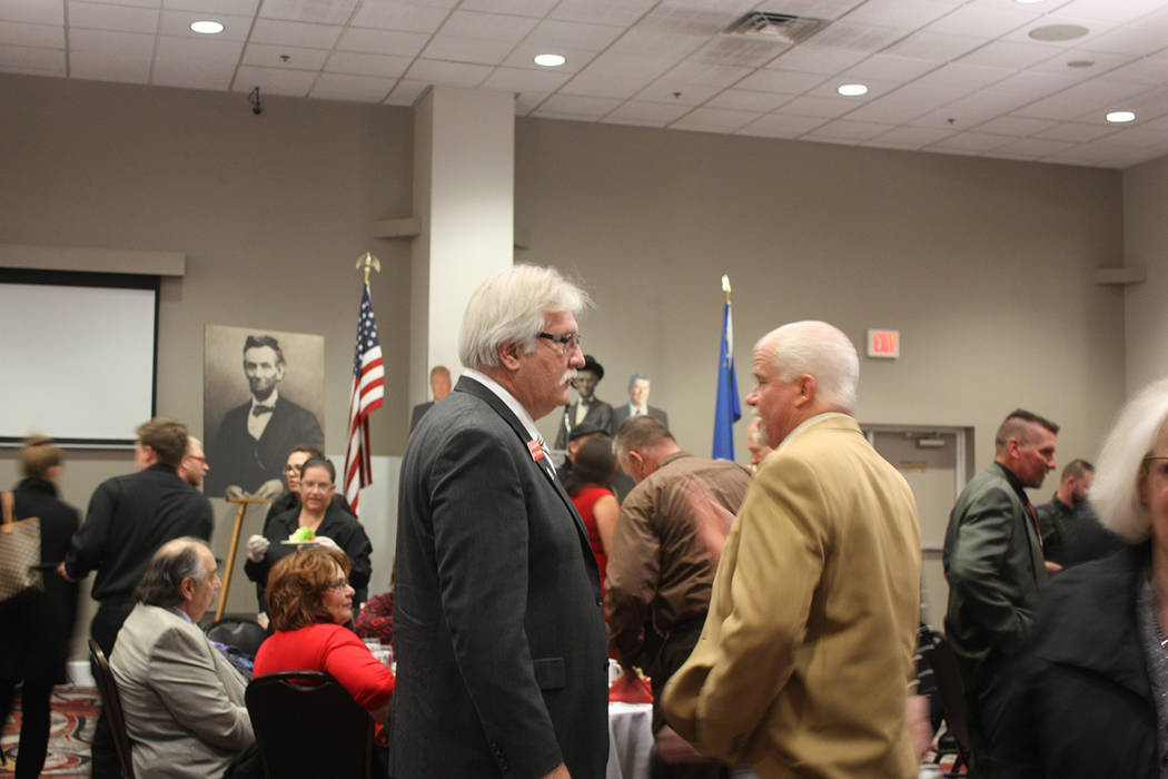 Robin Hebrock/Pahrump Valley Times Nye County Republican Central Committee Chairman Joe Burdzinski, left, chatted with Lincoln Dinner patrons as everyone settled in for an evening of Grand Old Par ...