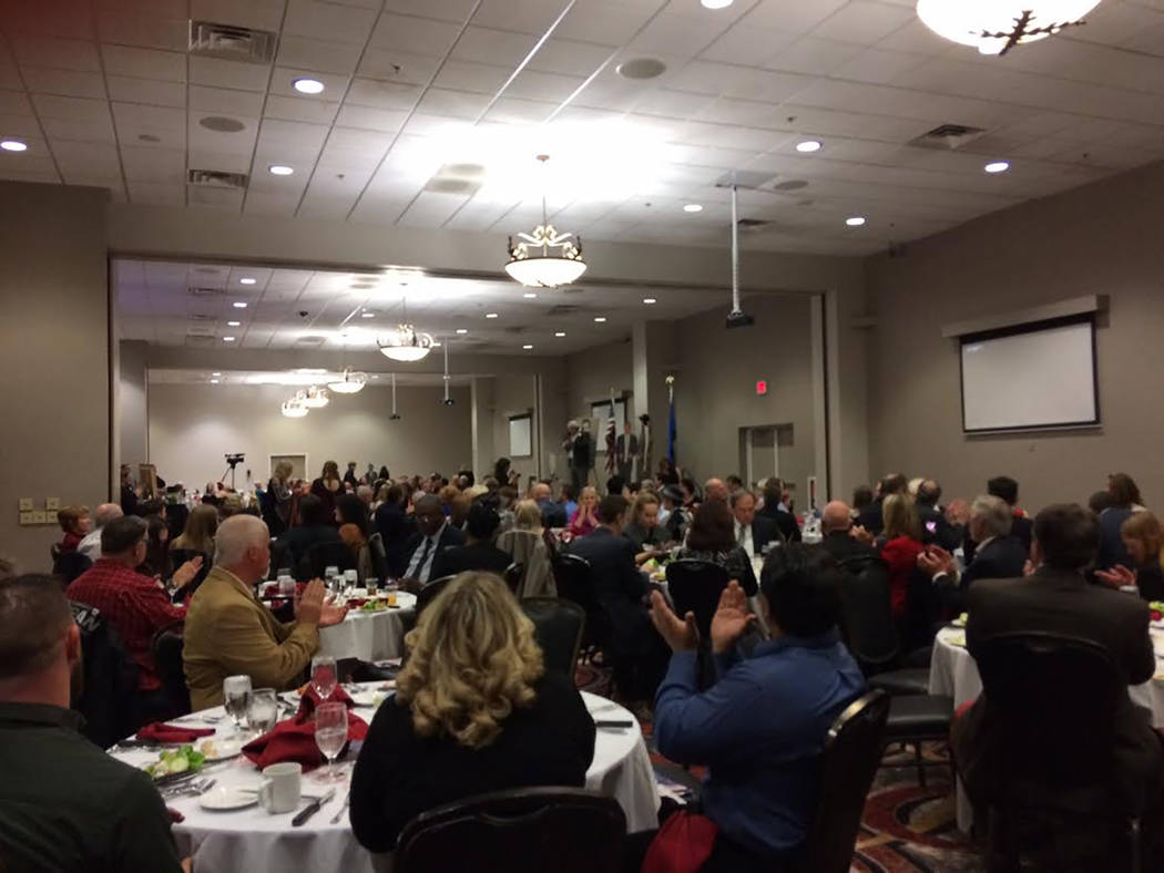 Robin Hebrock/Pahrump Valley Times The audience at the Lincoln Dinner is pictured applauding Joe Burdzinski's opening comments. He welcomed the crowd and primed them for the many political speeche ...