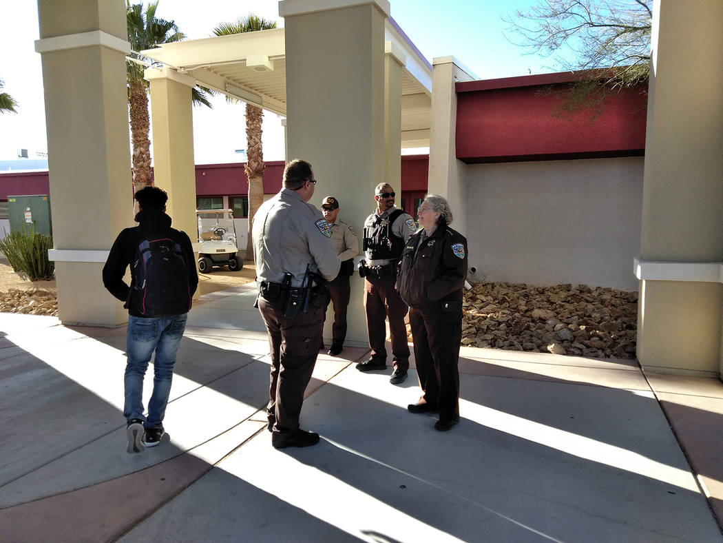 Selwyn Harris/Pahrump Valley Times Nye County Sheriff Sharon Wehrly stands guard with deputies at the entrance of Pahrump Valley High School on Monday morning. An anonymous written threat directed ...