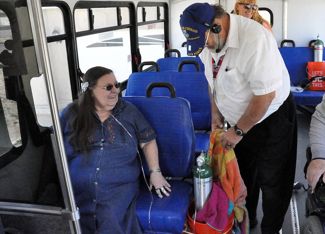 Horace Langford Jr. / Pahrump Valley Times VETrans bus driver Anold Bluder is shown securing Geogina Cross's oxygen bottle in this 2016 photo. The VETrans bus service started in June, 2016 and is  ...