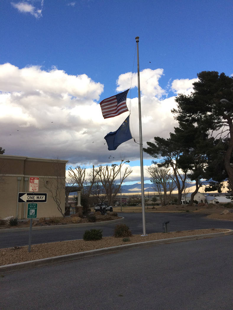 Robin Hebrock/Pahrump Valley Times The American and Nevada flags are shown flying at half-staff in Pahrump at the outside the Ian Deutch Government Complex on March 2. The flags were at half-mast  ...