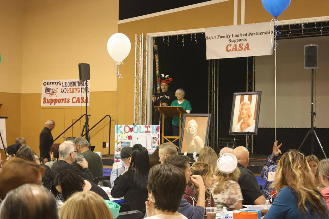 Robin Hebrock/Pahrump Valley Times Crab Fest founder Brian Kunzi and CASA Executive Director Willi Baer are shown addressing the crowd from the stage just before dinner was served. The two were de ...