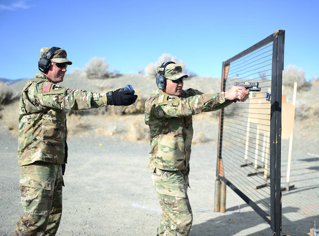 Sgt. Walter H. Lowell/Joint Force Headquarters  Master Sgt. Michael Clark, right, receives instruction from Maj. Robert Kolvet during a mock final shooting test for Nevada National Guard unit mars ...