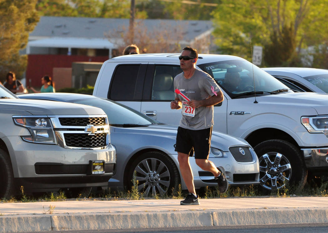 Horace Langford Jr./Pahrump Valley Times A Hawthorne, California, runner heads toward the Stage 11 exchange point during the Baker to Vegas Challenge Cup Relay last year along state Route 372.
