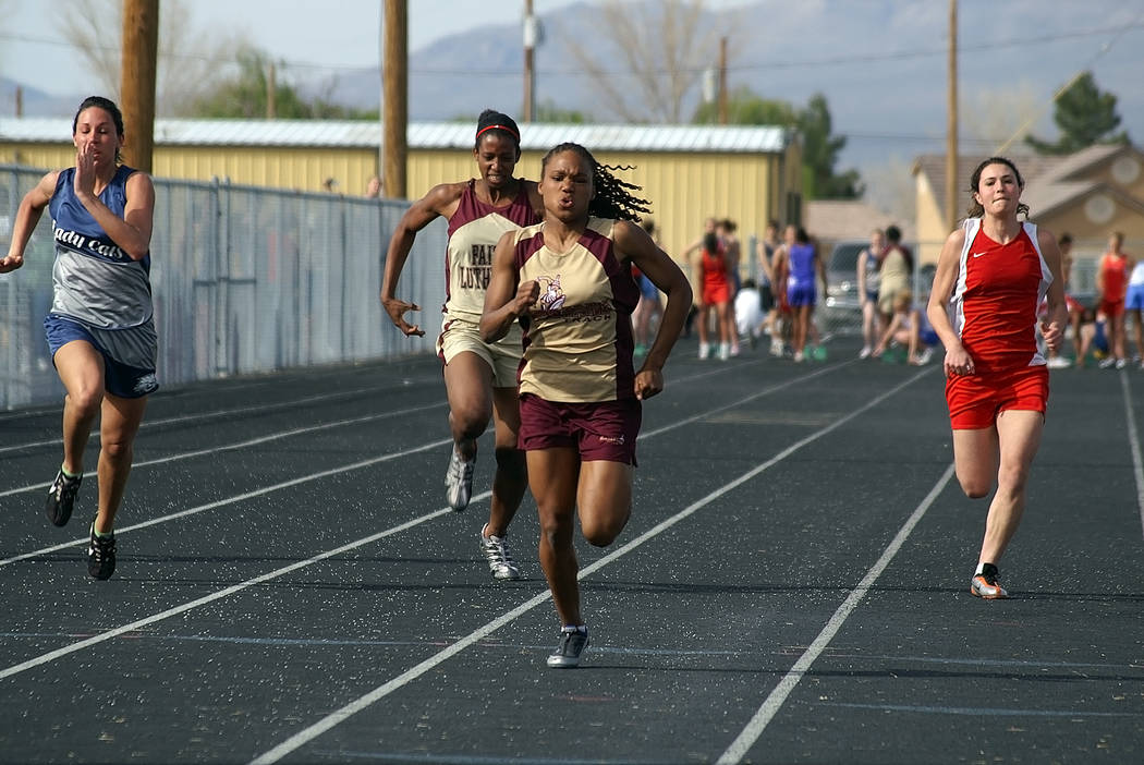 Horace Langford Jr./Pahrump Valley Times Dominique Maloy, center, as a sprinter at Pahrump Valley High School in 2005. The 15-time Class 3A state champion in track and field returns to the school  ...