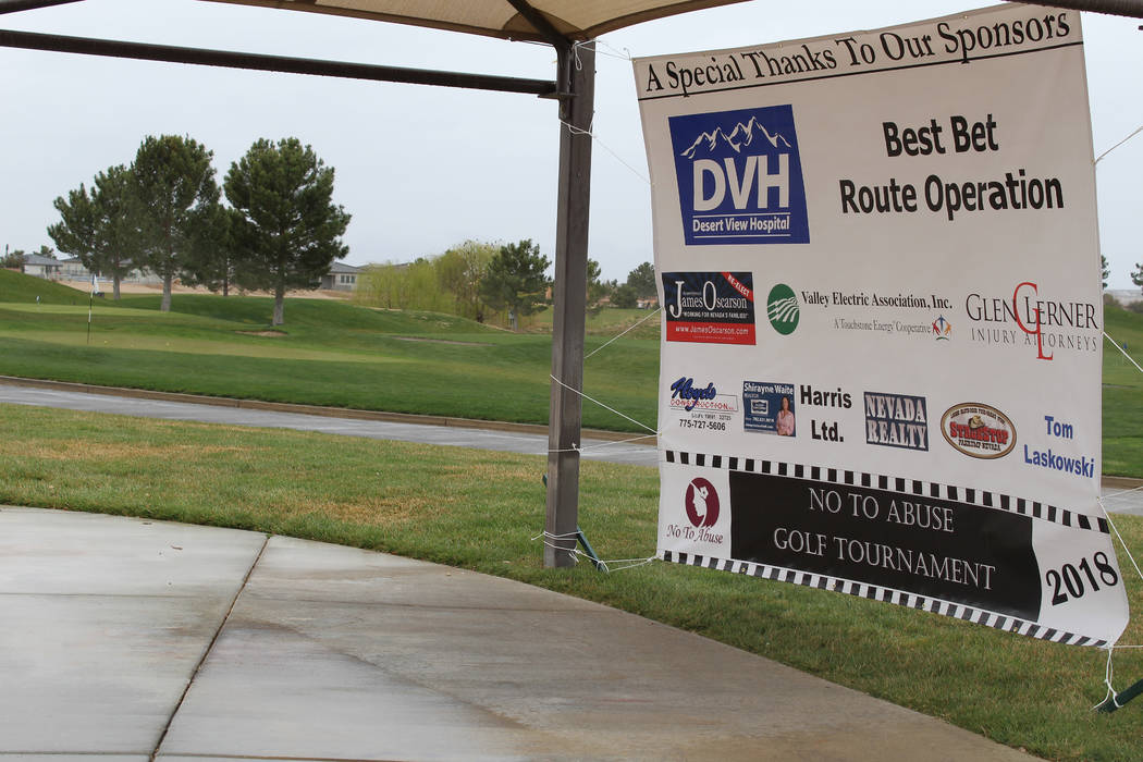 Tom Rysinski/Pahrump Valley Times Despite a gloomy, wet day at Mountain Falls Golf Course, the No To Abuse Golf Tournament drew 14 foursomes and raised money for No To Abuse of Pahrump.