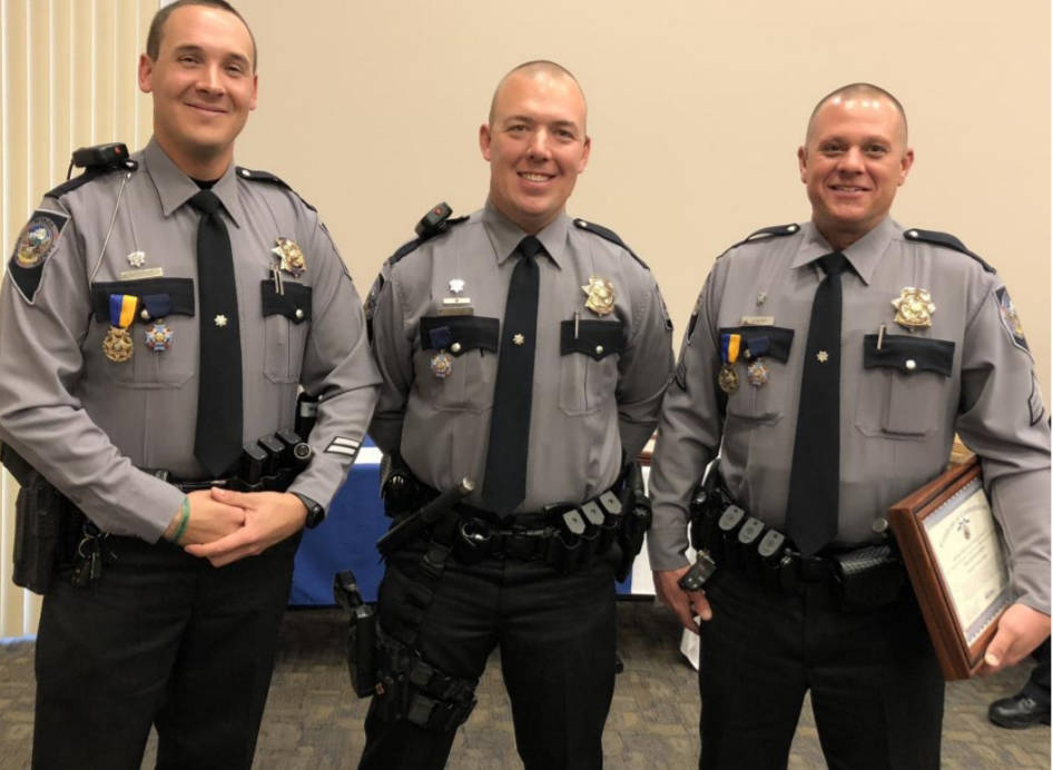 Special to the Pahrump Valley Times Trooper Adam Whitmarsh, Trooper Jacob Fisher and Sgt. Shawn Eckert were among those honored at the recent ceremony.