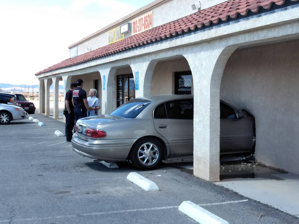 Selwyn Harris/Pahrump Valley Times Though Pahrump Valley Fire and Rescue Services medics were summoned, no injuries were reported after a car struck the front entrance area of the Tobin Hearing Ce ...