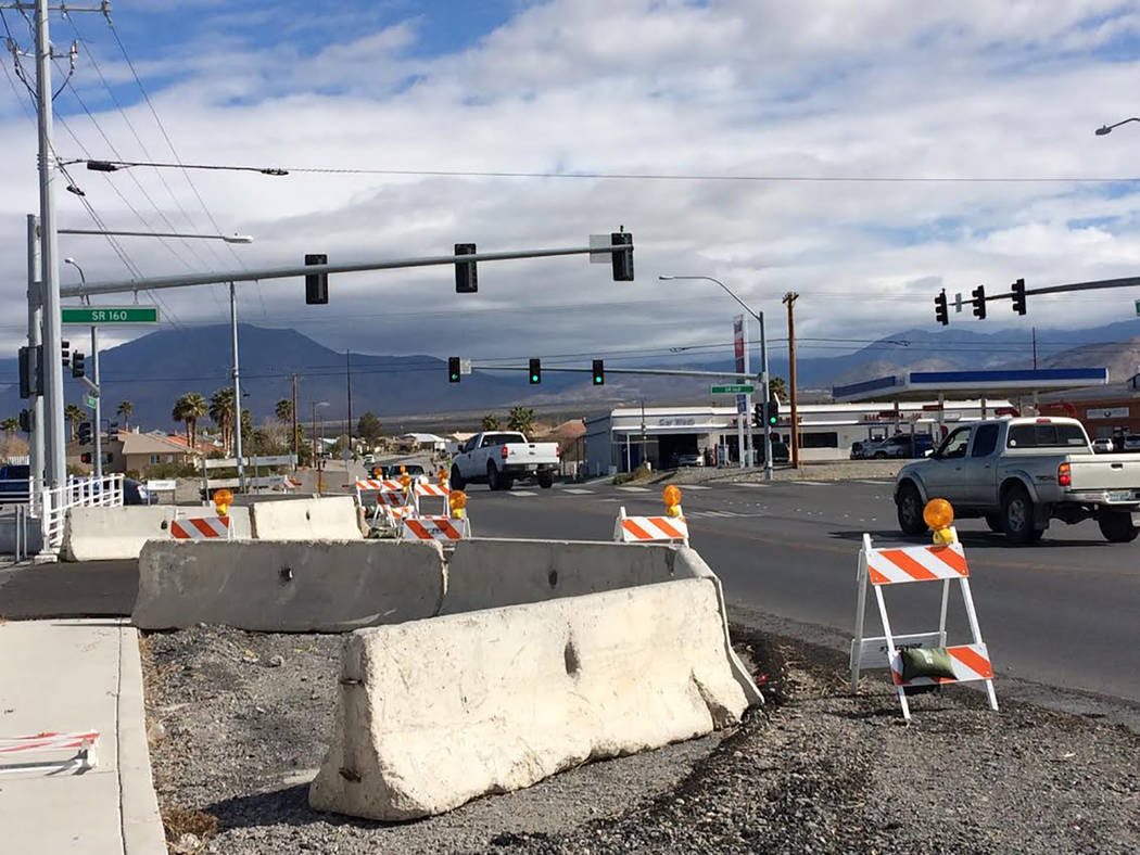 Robin Hebrock/Pahrump Valley Times The intersection of Homestead Road and Hwy. 160 in Pahrump is shown in this photo, taken March 13. Safety barriers have been in place for months as the road awai ...