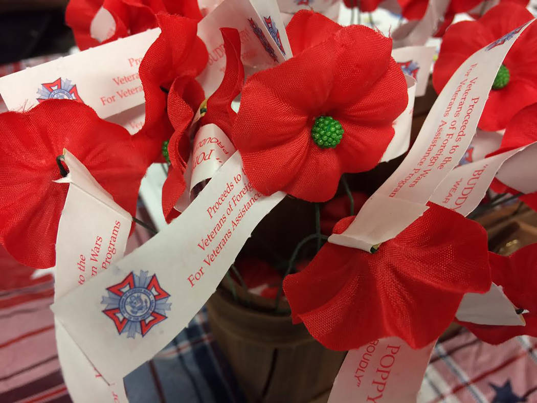 Robin Hebrock/Pahrump Valley Times The Veterans of Foreign Wars Post #10054 was one of the many vendors at the Veterans Extravaganza. The bright red Buddy Poppies shown are one method that the org ...