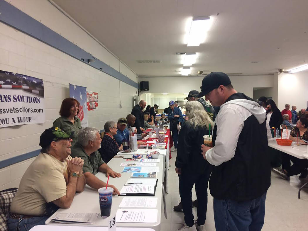 Robin Hebrock/Pahrump Valley Times Attendees are pictured speaking with members of the American Veterans Foundation of Pahrump and Homeless Veterans Solutions, two organizations that are working t ...