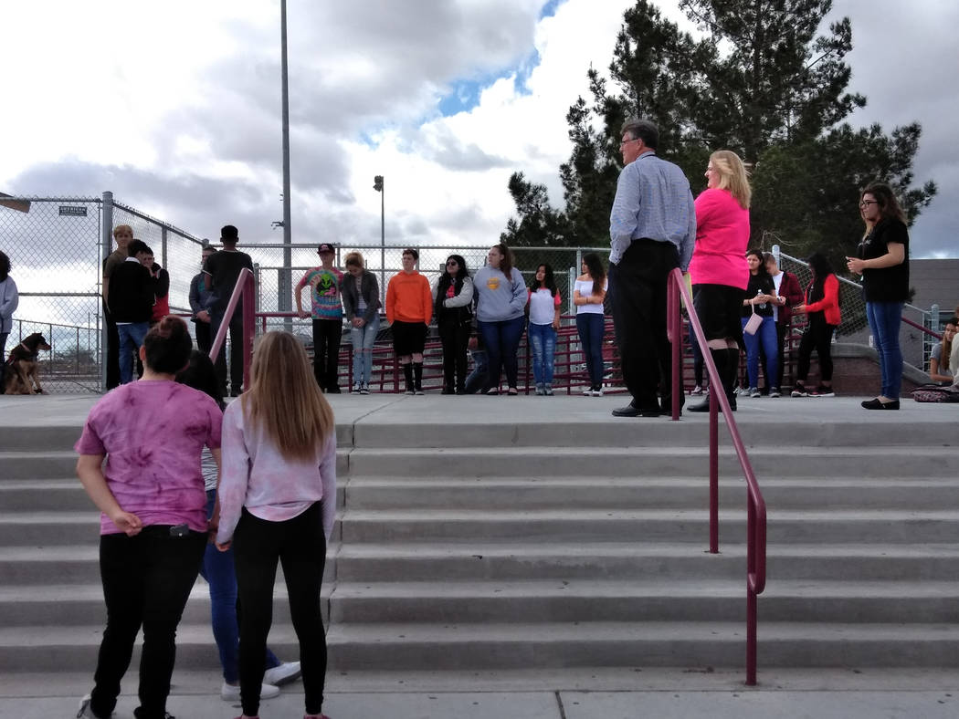 Selwyn Harris/Pahrump Valley Times Pahrump Valley High School Principal Jennifer Ehrheart (in pink shirt at the top of the stairwell), along with Assistant Principal Chuck Fannin (to her left), lo ...