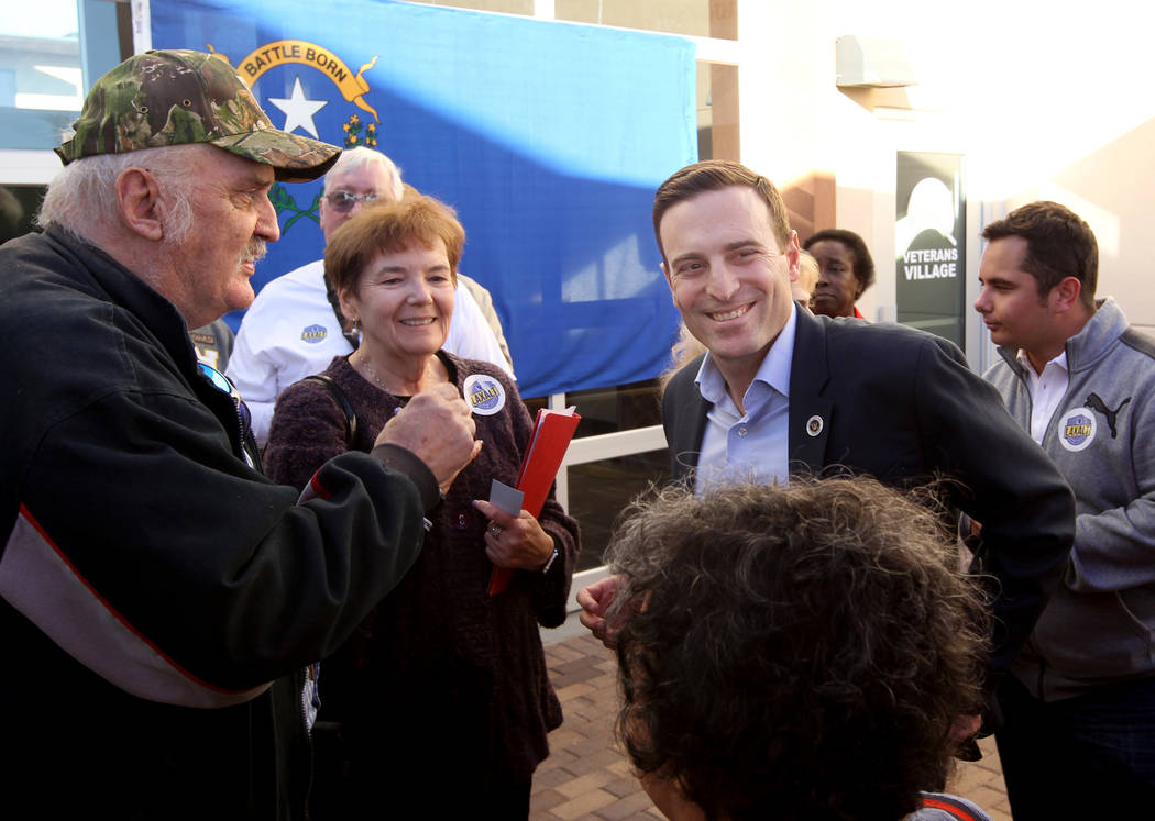 Republican gubernatorial candidate Nevada Attorney General Adam Laxalt, right, greets Glenn Noll, left, and Barbara Rodgick after speaking at Veterans Village in downtown Las Vegas Wednesday, Jan. ...
