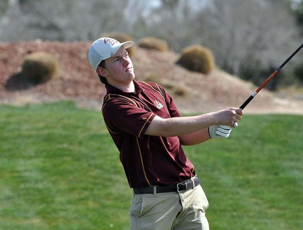 Horace Langford Jr./Pahrump Valley Times Pahrump Valley sophomore Koby Lindberg follows his tee shot on the first hole during the Pahrump Valley Invitational on March 8 at Mountain Falls Golf Cour ...