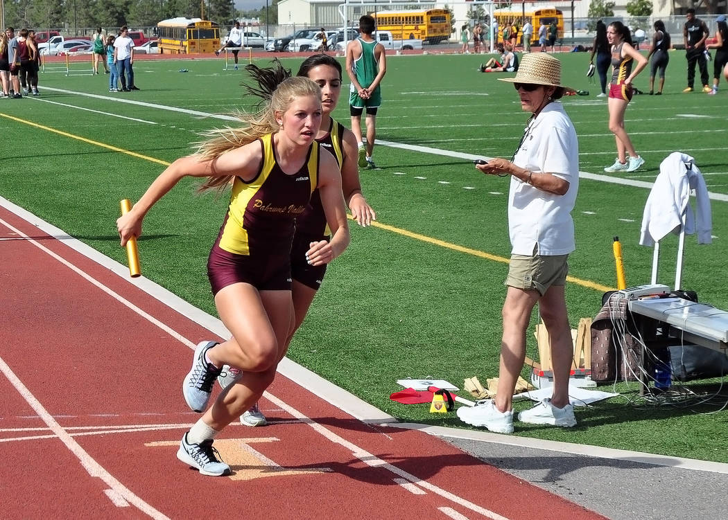Horace Langford Jr./Pahrump Valley Times Sydney Dennis, foreground, captured the 3,200 meters in 13 minutes, 30 seconds and ran on the second-place 4x400 team at the Western Weekday meet March 13  ...