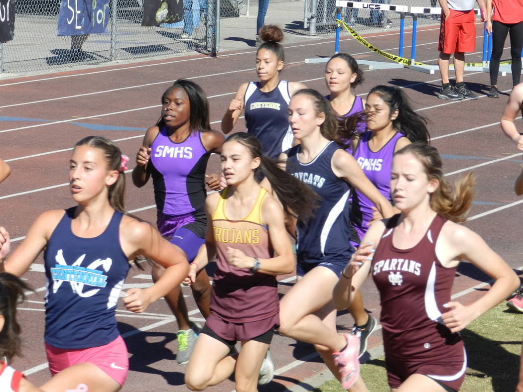 Horace Langford Jr./Pahrump Valley Times Grace Plumb, center, finished second in the 3,200 meters and was part of the second-place 4x400 team for Pahrump Valley at the first of the season's weekda ...