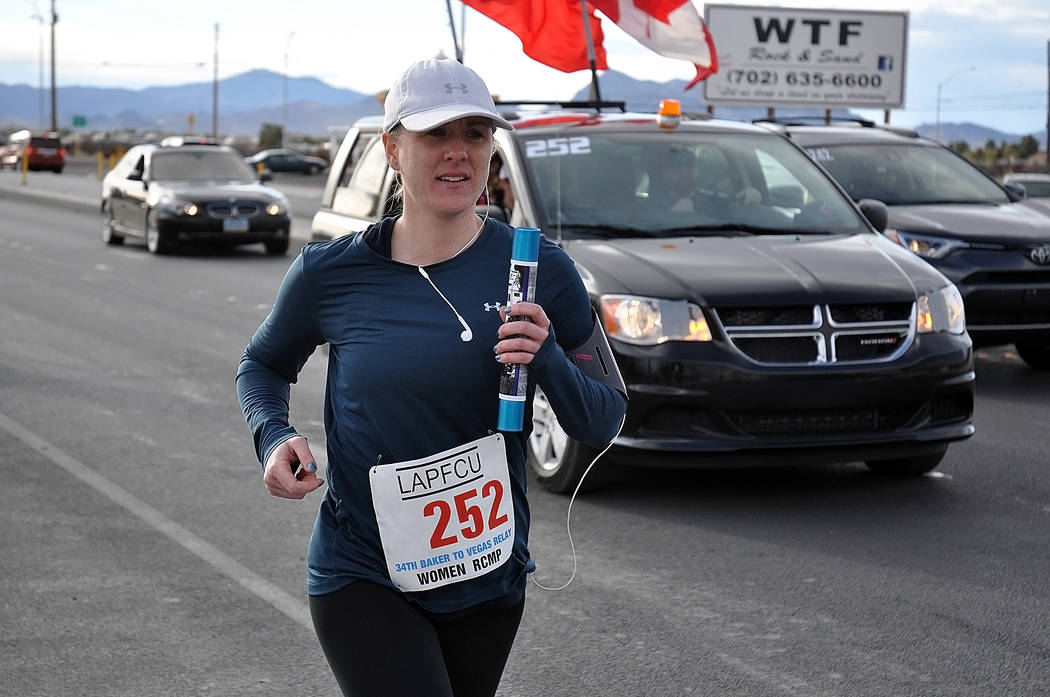 Horace Langford Jr./Pahrump Valley Times A runner from the Royal Canadian Mounted Police women's team approaches an exchange point during the 34th Baker to Vegas Challenge Cup Relay on Saturday.