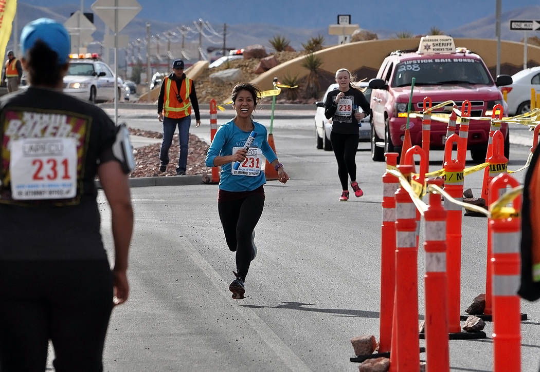 Horace Langford Jr./Pahrump Valley Times Runners from the U.S. Attorney's Office Team No. 2, left, and the Riverside County, California, Sheriff's Deparment women's team arrive Saturday at the Gre ...