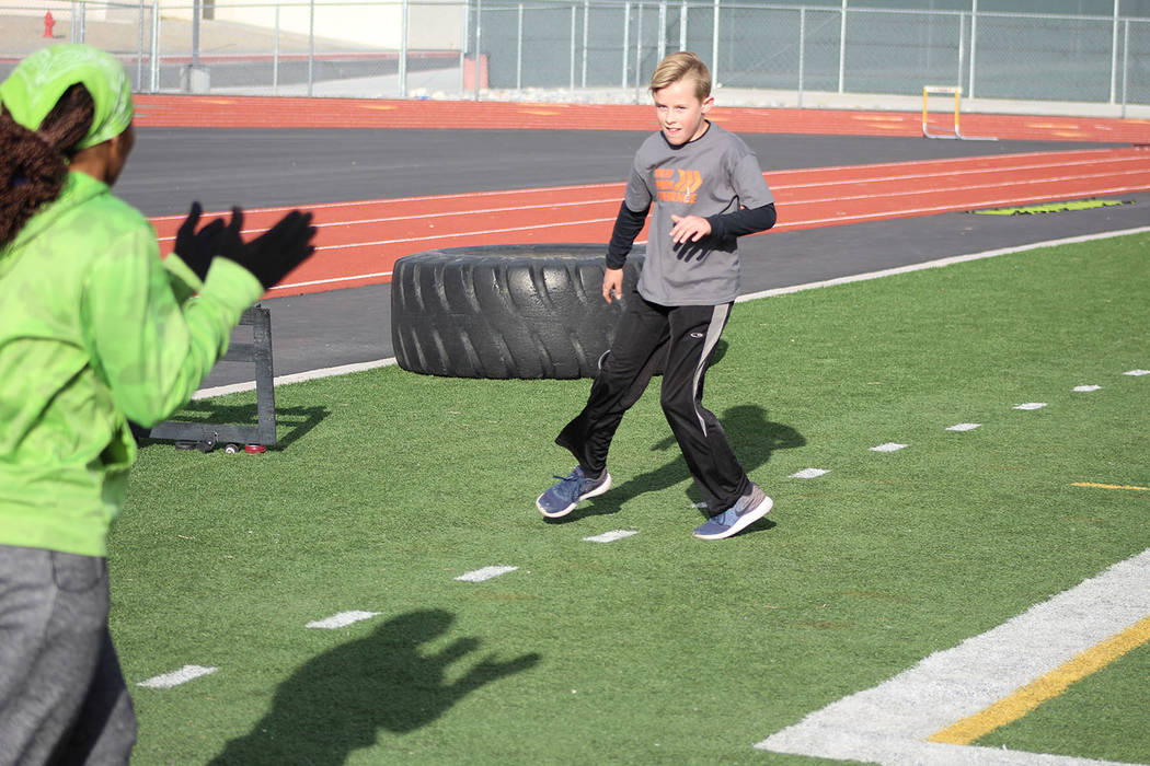 """Tom Rysinski/Pahrump Valley Times Dominique Maloy, left, cheers on Dane Clayton, 11, as he completes an agility drill during the first weekend of Maloy's """"A Youth Sports Experience"""" at Pahrump Val ..."""