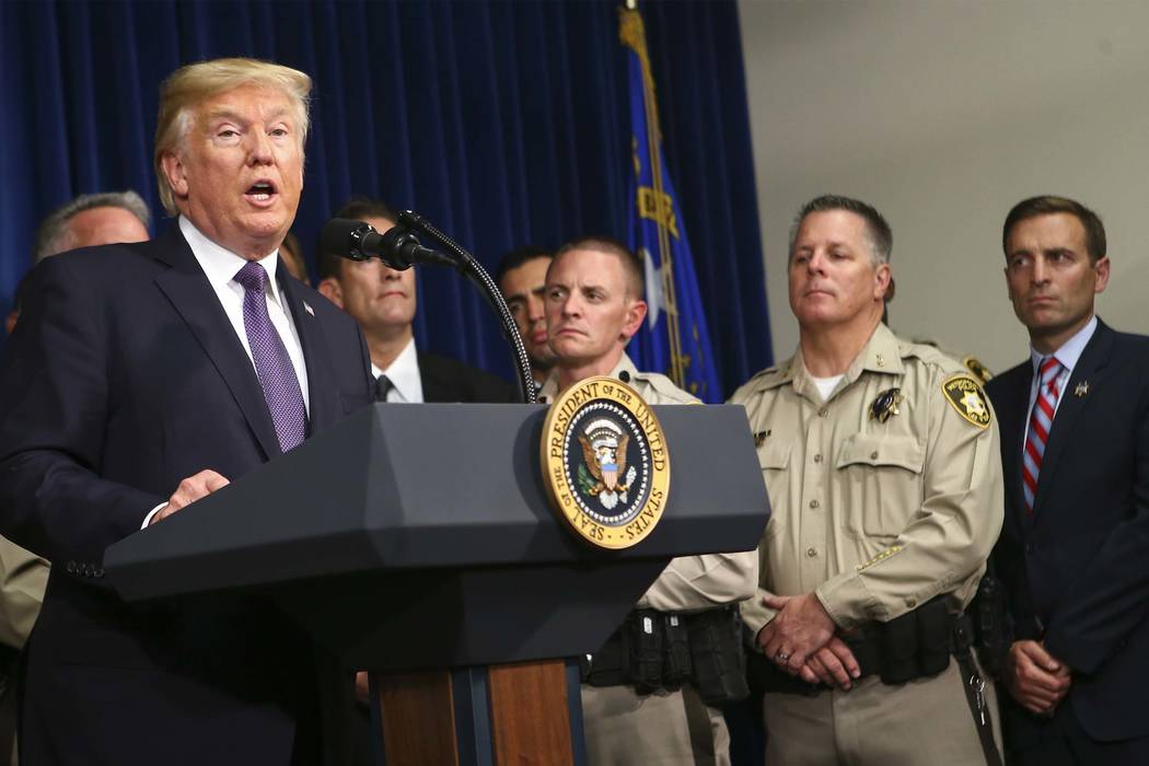 President Donald Trump speaks at Metropolitan Police Department headquarters in Las Vegas on Wednesday, Oct. 4, 2017. A gunman opened fire on attendees of a music festival Sunday night, resulting  ...
