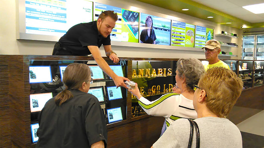 Special to the Pahrump Valley Times Grove manager Zachary Wright provides information on the many marijuana-infused products sold at the business. The Grove first opened its doors for medical mari ...