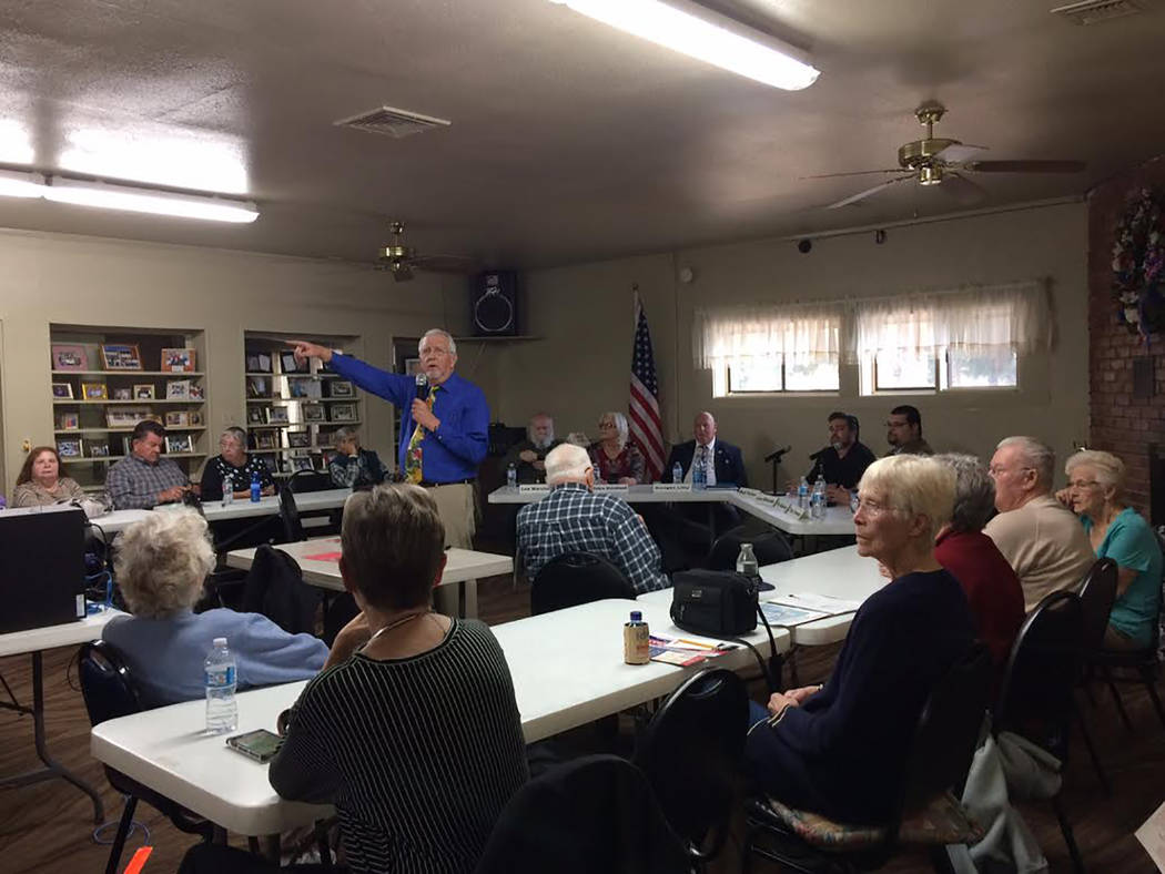 Robin Hebrock/Pahrump Valley Times Nye County Commission Candidates Forum co-organizer Bill Newyear is pictured standing before a panel of political hopefuls while surrounded by a crowd of voters  ...