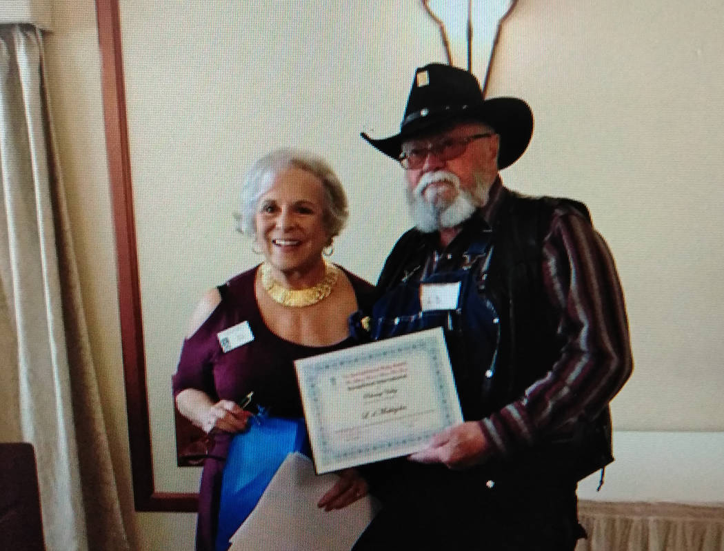 Special to the Pahrump Valley Times  Pahrump resident L.D. Meiklejohn right, receives the Ruby Award from officials with the Soroptimist International Pahrump Valley organization for his support t ...