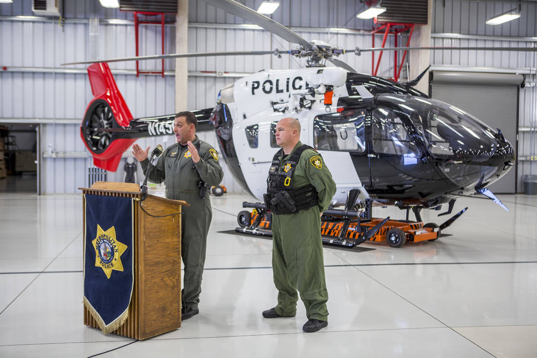 Chief Pilot Steve Morris Jr., left, speaks about the new Las Vegas police helicopter while pilot Bryan Woolard stands by at the North Las Vegas Airport on Aug. 16, 2017. (Patrick Connolly/Las Vega ...