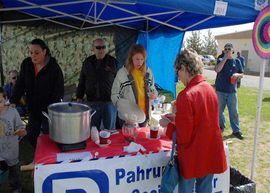 Selwyn Harris / Pahrump Valley Times Officials from the Pahrump Senior Center serve up a cup of their award-winning chili during 2016's event.  This year's annual Silver State Chili Cook-off retur ...