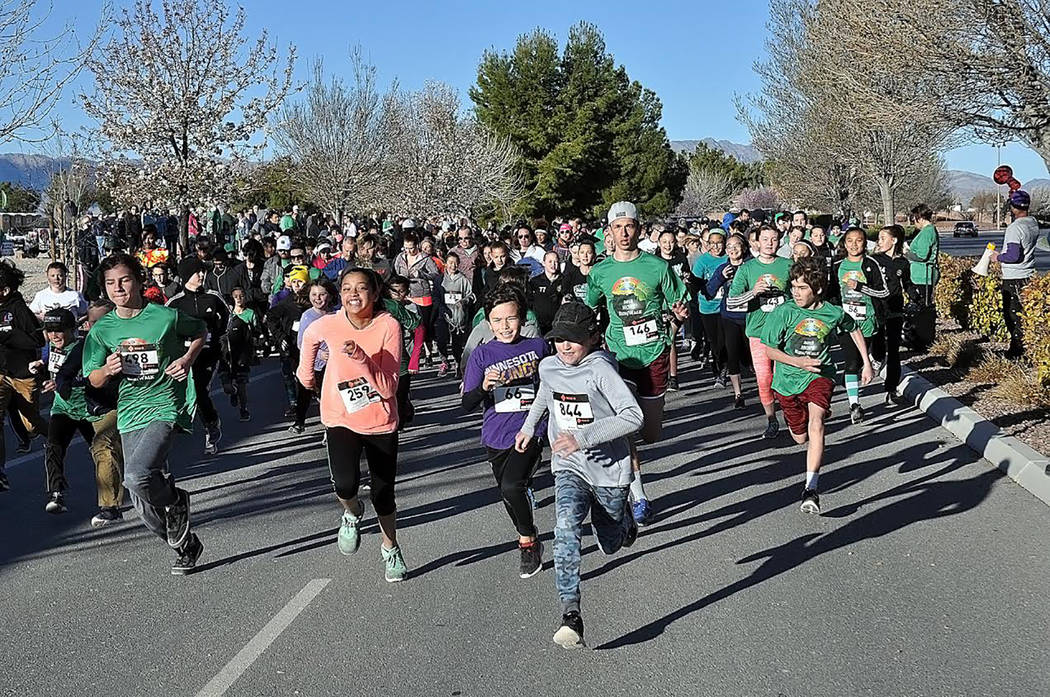 Horace Langford Jr./Pahrump Valley Times  The cue for the 2018 HOPE Run/Walk to begin signaled a mad dash from the starting line, with valley students eagerly running down the track as seen in thi ...