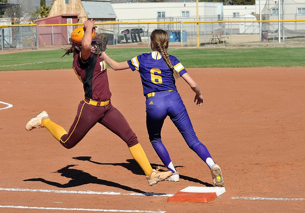 Horace Langford Jr./Pahrump Valley Times McKayla Bartley of Pahrump Valley is safe on an infield single March 23 against Durango. Bartley went 2-for-4 and scored three runs in the Trojans' 11-8 vi ...