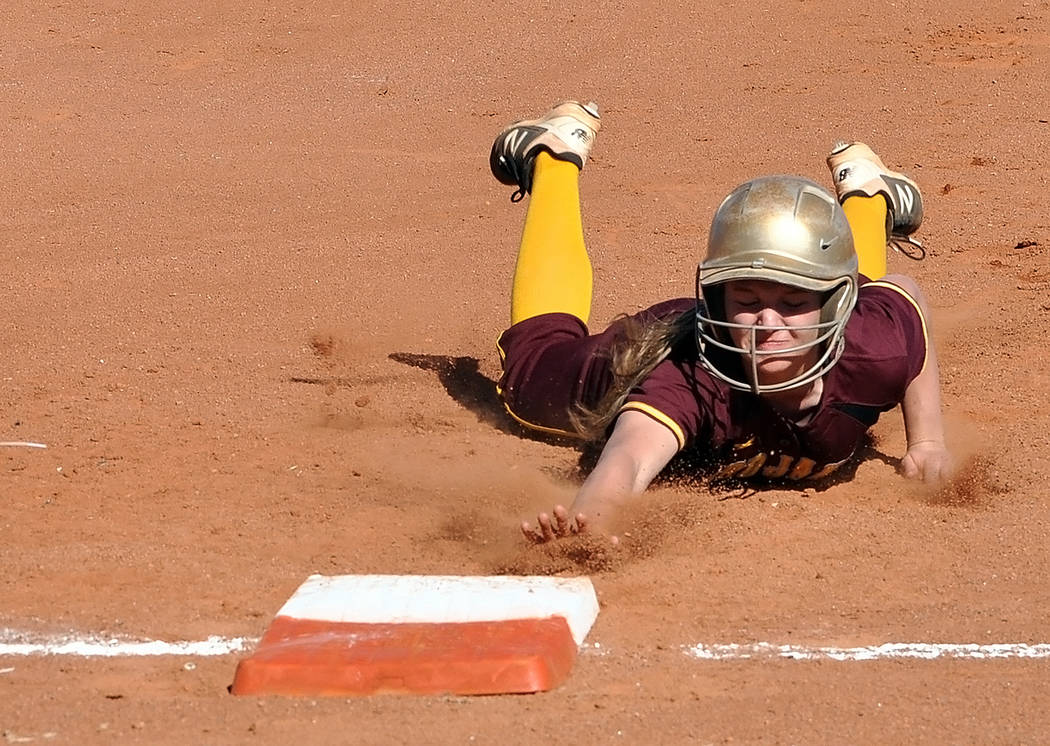 Horace Langford Jr./Pahrump Valley Times Jackie Stobbe of Pahrump Valley gets back safely to first base during the Trojans' 11-8 win over Durango on March 23 at Pahrump Valley High School.