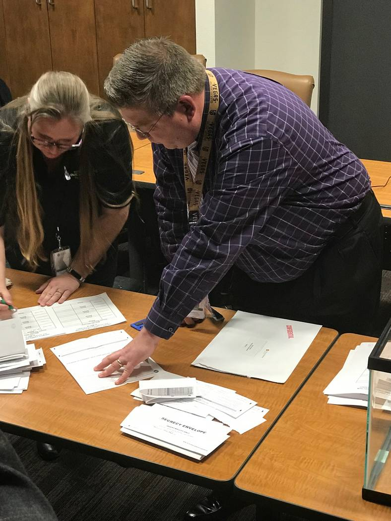 Jeffrey Meehan/Pahrump Valley Times The final ballots are tallied for Valley Electric Association's board of directors position in District 1 (south Pahrump) on March 22, 2018 at the cooperative's ...