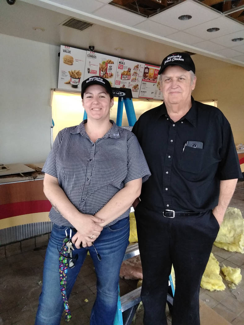 Selwyn Harris/Pahrump Valley Times Pahrump KFC Manager Melissa Smith, left, along with Area Manager Steve Utley, stand amid debris in the lobby area as an image enhancement project is now underway ...