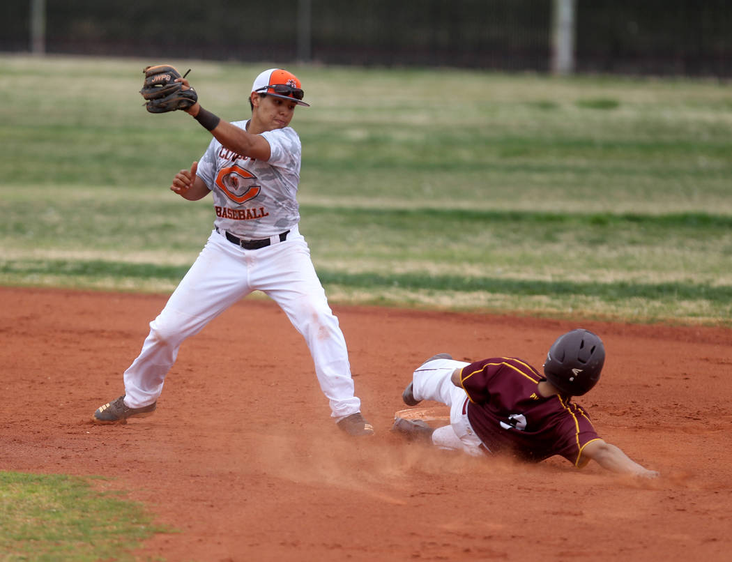 K.M. Cannon/Las Vegas Review-Journal Pahrump Valley's Bradda Costa slides safely into second base as Chaparral shortstop James Cobian fields the throw during the second inning of their baseball ga ...
