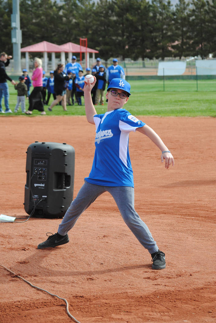 Charlotte Uyeno/Pahrump Valley Times John Bautista, who plays for the AAA Dodgers, throws out the P-Town Little League's ceremonial first pitch March 24 at Ian Deutch Memorial Park. The pitch was  ...