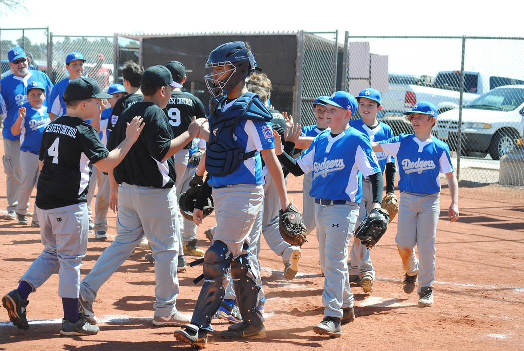 Charlotte Uyeno/Pahrump Valley Times The Major Dodgers and Rockies exchange traditional postgame high-fives on the opening day of Pahrump's Little League baseball season March 24 at Deutch Memoria ...