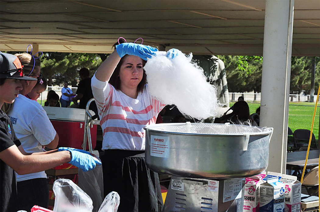 Selwyn Harris/Pahrump Valley Times Cotton candy and kettle corn are just a few of the treats offered at Saturday's Community Easter Picnic. Hamburgers, hot dogs, ice cream and snow cones are also  ...