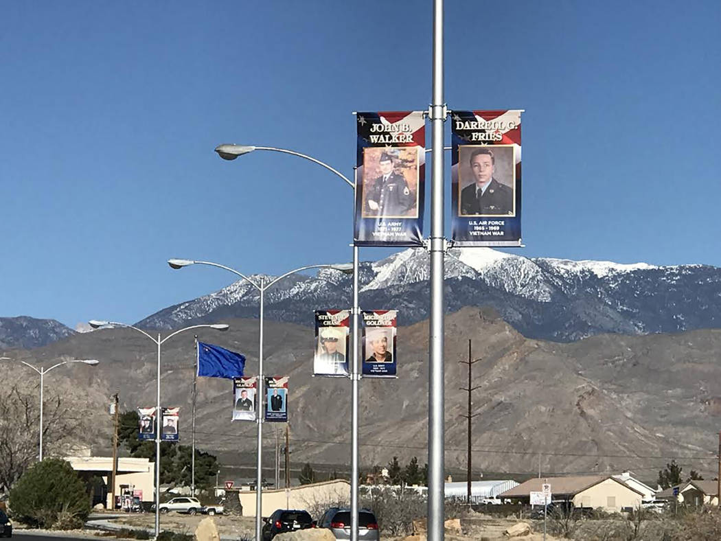 Special to the Pahrump Valley Times A view down Calvada Blvd. where a total of 11 banners featuring 21 Nye County veterans have been hung. The banners program was created by the American Veterans  ...
