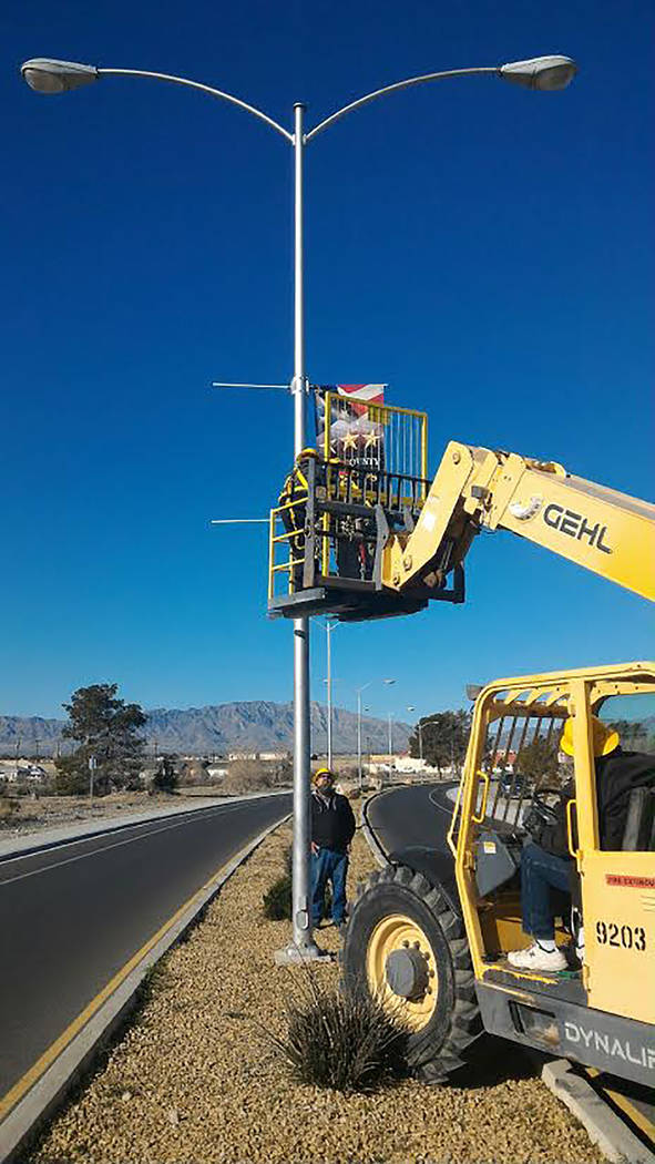 Special to the Pahrump Valley Times Nye County employees and members of the American Veterans Foundation of Pahrump were out on March 27 to hang the first round of banners in the Nye County Vetera ...