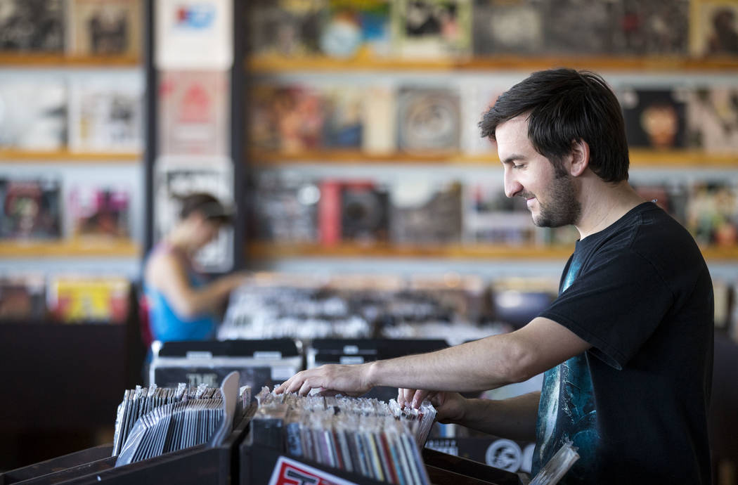 Richard Brian/Las Vegas Review-Journal  Las Vegas resident Taylor Blake browses the vinyl records at 11th Street Records on Small Business Saturday, Nov. 25, 2017, in downtown Las Vegas.