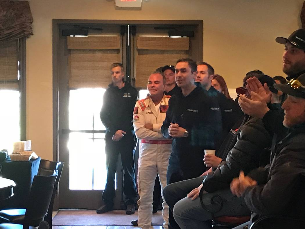Jeffrey Meehan/Pahrump Valley Times Spring Mountain Motor Resort and Country Club owner John Morris stands with team members from British supercar maker McLaren and others inside the clubhouse of ...