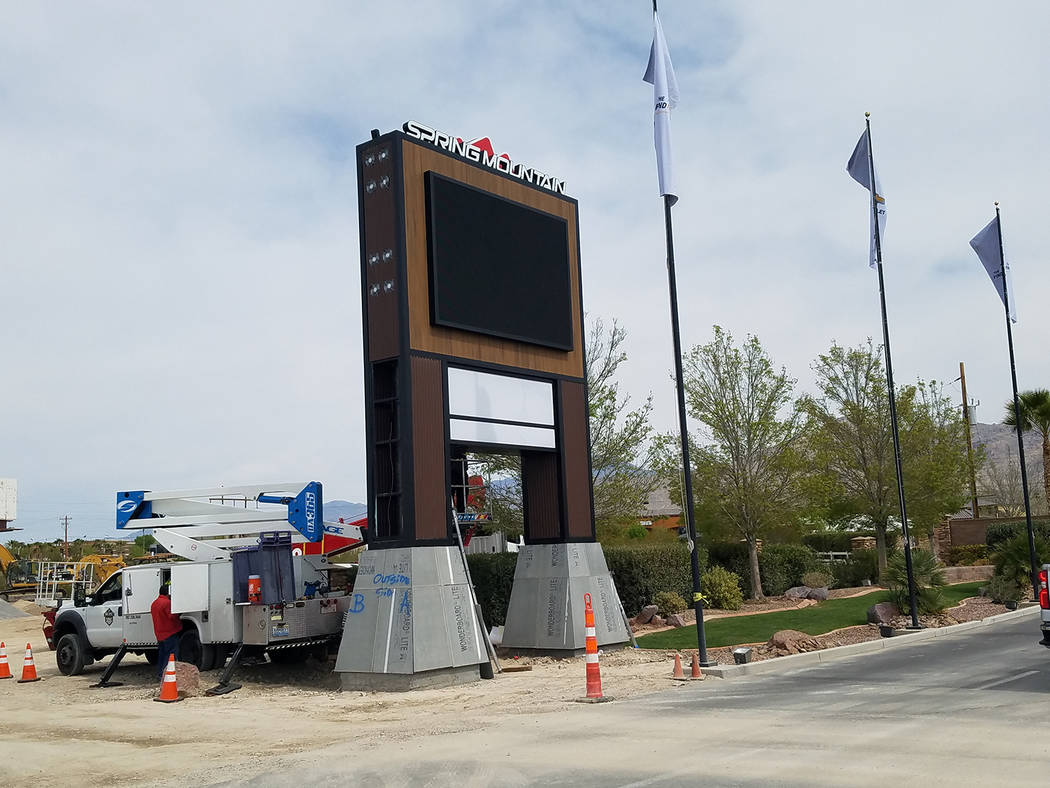 David Jacobs/Pahrump Valley Times Crews this spring install a new sign outside the Spring Mountain Motor Resort and Country Club near Nevada Highway 160. The race facility received approval on a f ...