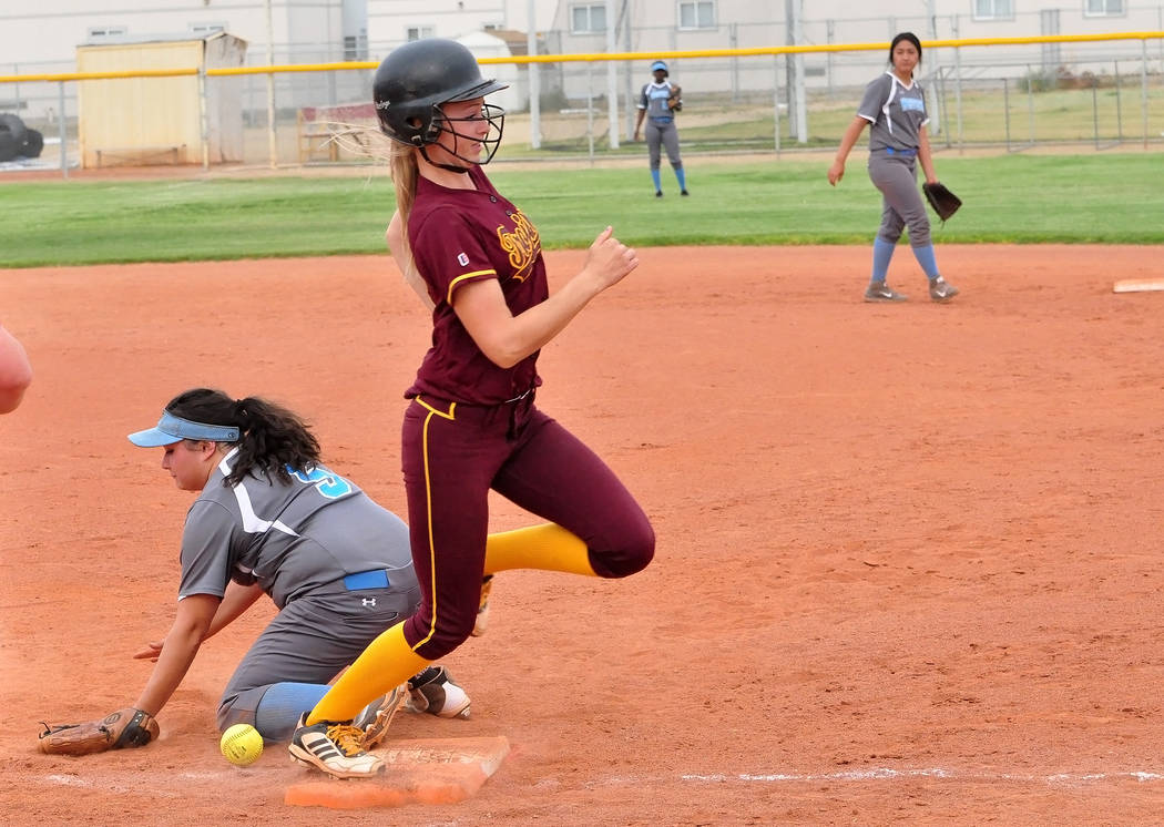 Horace Langford Jr./Pahrump Valley Times Evandy Murphy squeezed home the tying run in the bottom of the seventh inning Saturday in Pahrump Valley's 11-10 win over Fernley in the Centennial Spring  ...