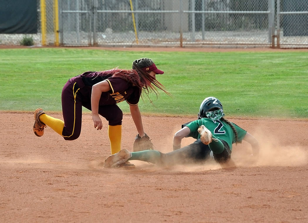 Horace Langford Jr./Pahrump Valley Times Pahrump Valley second baseman Skyler Lauver hit a key single in the seventh inning Saturday and scored the winning run as the Trojans defeated defending st ...